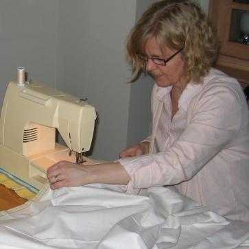Joyce is sewing.